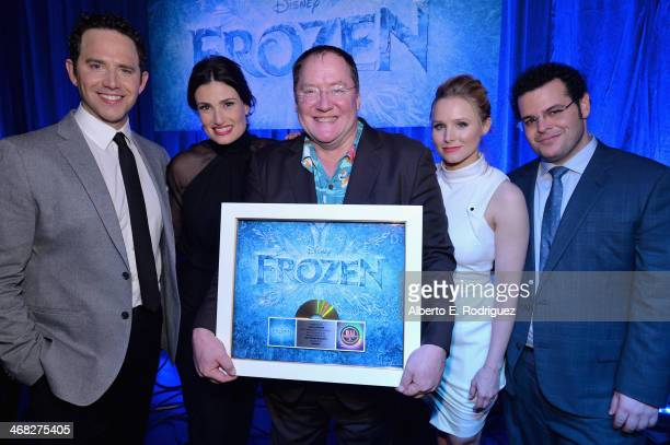 Executive producer John Lasseter and the cast of Disney's 'Frozen' were presented with gold records commemorating the success of the 'Frozen'...
