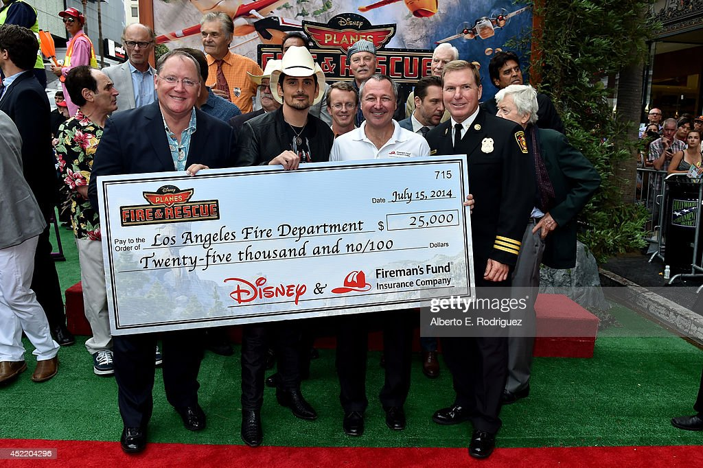 Executive producer <a gi-track='captionPersonalityLinkClicked' href=/galleries/search?phrase=John+Lasseter&family=editorial&specificpeople=224003 ng-click='$event.stopPropagation()'>John Lasseter</a>, singer/songwriter <a gi-track='captionPersonalityLinkClicked' href=/galleries/search?phrase=Brad+Paisley&family=editorial&specificpeople=206616 ng-click='$event.stopPropagation()'>Brad Paisley</a> and Marketing at Fireman's Fund Insurance Company, Paul Fuegner attend World Premiere Of Disney's 'Planes: Fire & Rescue' at the El Capitan Theatre on July 15, 2014 in Hollywood, California.