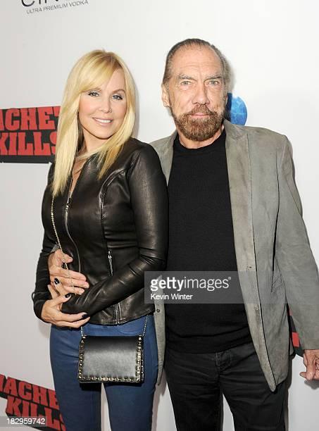 Executive producer John Paul DeJoria and Eloise Broady arrive at the premiere of Open Road Films' 'Machete Kills' at Regal Cinemas LA Live on October...