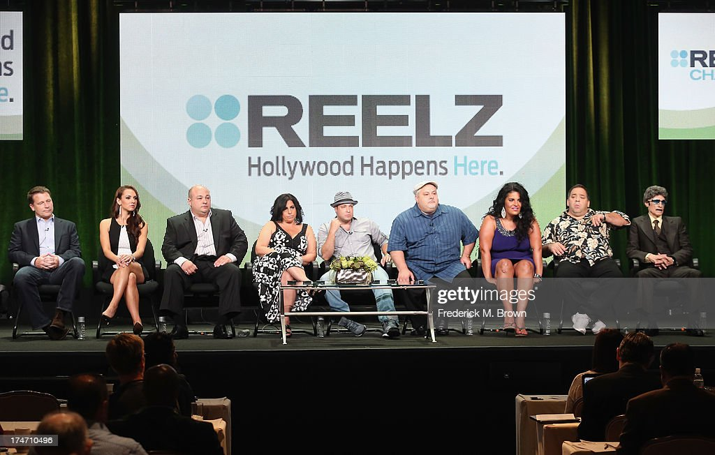 Executive Producer Jonathan Koch, tv personalities Staci Richter, Dominic Capone, Dawn Capone, Bartolomeo Tumbarello, Carmine Perelli, Madeline Santarelli, Jeff Vercillo and Lou Fratto speak onstage during 'The Capones' panel discussion at the REELZCHANNEL portion of the 2013 Summer Television Critics Association tour at the Beverly Hilton Hotel on July 28, 2013 in Beverly Hills, California.