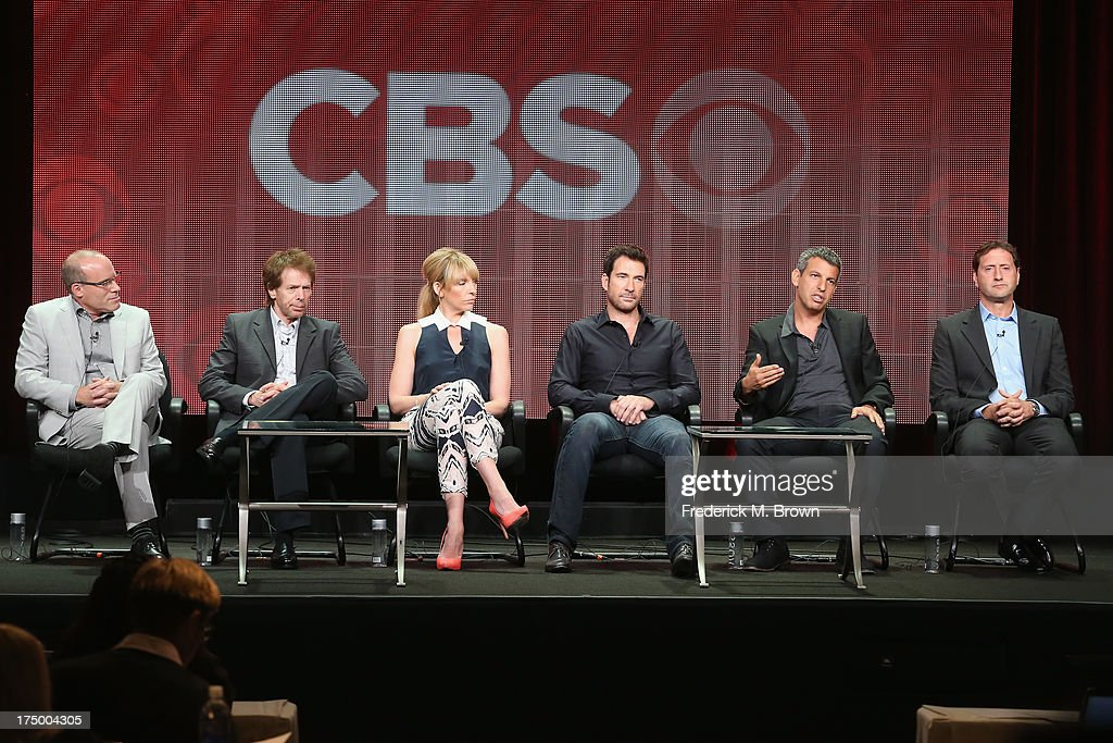 Executive Producer Jonathan Littman, executive producer Jerry Bruckheimer, actors Toni Collette, Dylan McDermott, executive producer/writer/director Jeffrey Nachmanoff and executive producer/writer Rick Eid speak onstage during the 'Hostages' panel discussion at the CBS, Showtime and The CW portion of the 2013 Summer Television Critics Association tour at the Beverly Hilton Hotel on July 29, 2013 in Beverly Hills, California.