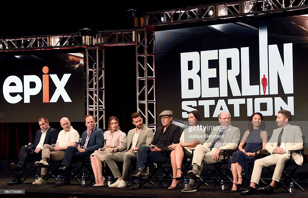 Executive producer Keith Redmon, creator/executive producer Olen Steinhauer, showrunner/executive producer Bradford Winters, actress Mina Tander, actor Richard Armitage, actor Rhys Ifans, actress Michelle Forbes, actor Richard Jenkins, actress Tamlyn Tomita and actor Leland Orser of 'Berlin Station' speak onstage during the EPIX TCA presentation at The Beverly Hilton Hotel on July 30, 2016 in Beverly Hills, California.