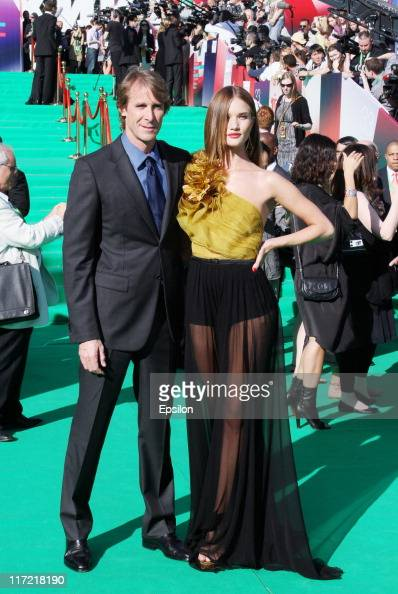 Executive producer Michael Bay and actress Rosie HuntingtonWhiteley attend at the premiere of the 'Transformers Dark of the Moon' during the 33d...