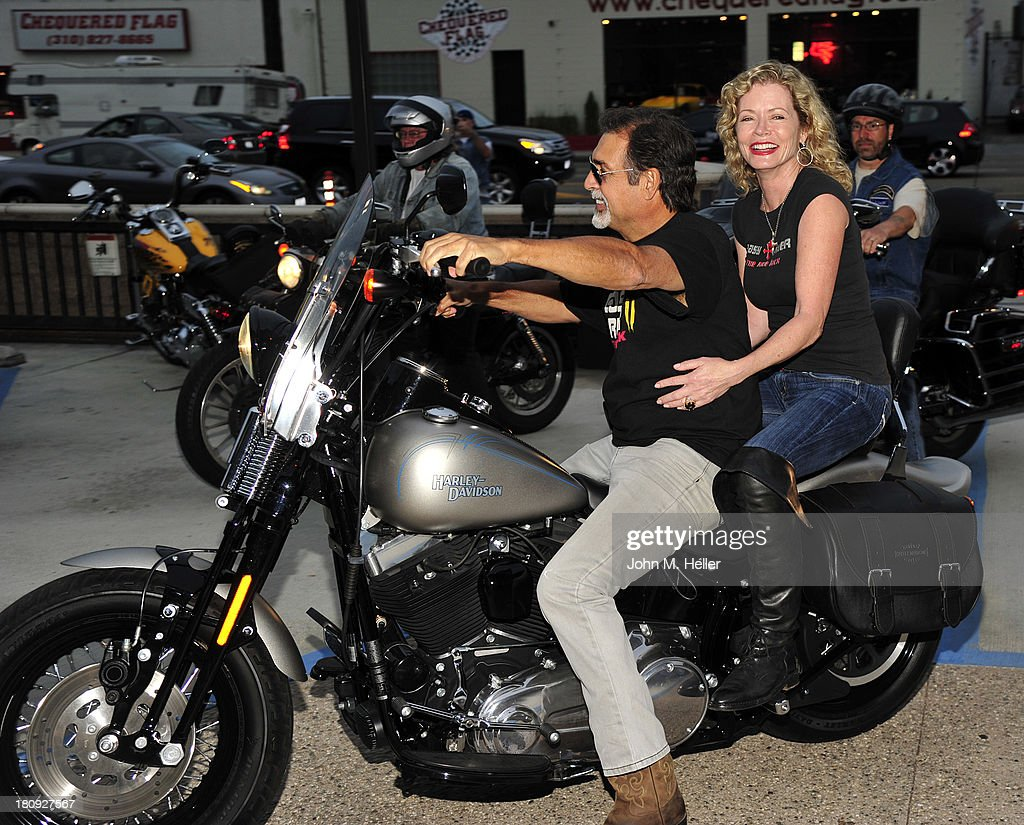 Executive Producer of 'Easy Rider The Ride Back' Vince Morella and actress/producer of 'Easy Rider The Ride Back' <a gi-track='captionPersonalityLinkClicked' href=/galleries/search?phrase=Sheree+J.+Wilson&family=editorial&specificpeople=799239 ng-click='$event.stopPropagation()'>Sheree J. Wilson</a> attend the premiere of 'Easy Rider The Ride Back' Ride-In at Bartels' Harley-Davidson on September 17, 2013 in Marina del Rey, California.