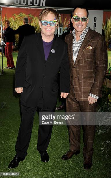 Executive Producer Sir Elton John and Producer David Furnish attend the UK film premiere of Gnomeo and Juliet at Odeon Leicester Square on January 30...