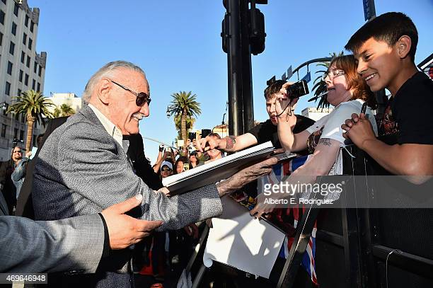 executive producer Stan Lee signs autographs for fans at the world premiere of Marvel's 'Avengers Age Of Ultron' at the Dolby Theatre on April 13...