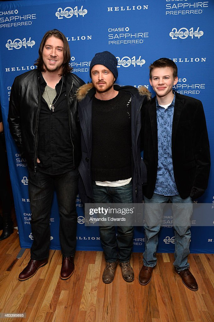 Executive producer Tanner Beard and actors Aaron Paul and Josh Wiggins arrive at the 'Hellion' premiere party at Chase Sapphire on January 17, 2014 in Park City, Utah.
