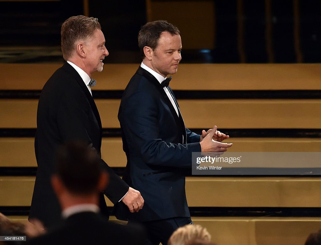 Executive Producer Warren Littlefield (L) and Show Creator/Executive Producer Noah Hawley, walk onstage to accept the Outstanding Miniseries Award for 'Fargo' during the 66th Annual Primetime Emmy Awards held at Nokia Theatre L.A. Live on August 25, 2014 in Los Angeles, California.