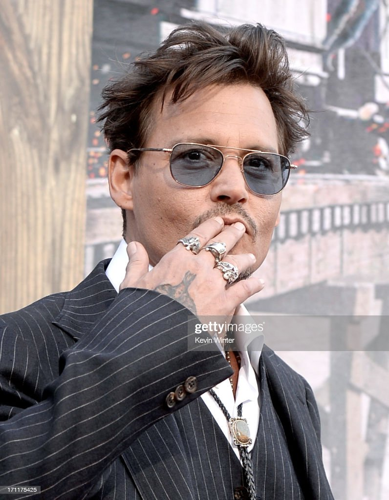 Executive producer/actor <a gi-track='captionPersonalityLinkClicked' href=/galleries/search?phrase=Johnny+Depp&family=editorial&specificpeople=202150 ng-click='$event.stopPropagation()'>Johnny Depp</a> arrives at the premiere of Walt Disney Pictures' 'The Lone Ranger' at Disney California Adventure Park on June 22, 2013 in Anaheim, California.