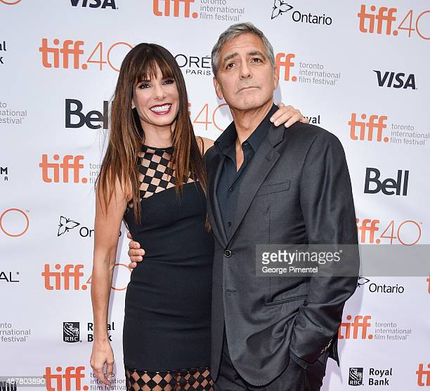 Executive Producer/Actress Sandra Bullock and Producer George Clooney attend the 'Our Brand is Crisis' premiere during the 2015 Toronto International...