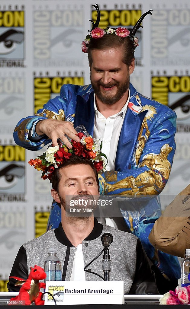 Executive producer/creator Bryan Fuller puts a flower crown on actor Richard Armitage at the 'Hannibal' Savor the Hunt panel during Comic-Con International 2015 at the San Diego Convention Center on July 11, 2015 in San Diego, California.