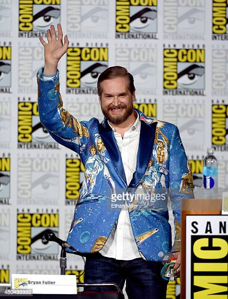 Executive producer/creator Bryan Fuller waves onstage at the 'Hannibal' Savor the Hunt panel during ComicCon International 2015 at the San Diego...