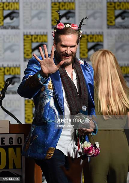 Executive producer/creator Bryan Fuller waves to fans at the 'Hannibal' Savor the Hunt panel during ComicCon International 2015 at the San Diego...
