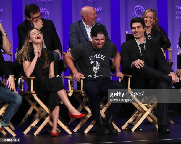 Executive producers Andrew Kreisberg Marc Guggenheim and Wendy Mericle and actors Melissa Benoist Stephen Amell and Brandon Routh appear on stage at...