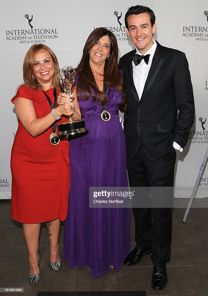 Executive Producers Cecilia Mendonca and Maria Laura Moure, and presenter Sam Moran with the Kids: Preschool Emmy Award for 'El Jardin de Clarilu' attend The Inaugural International Emmy Kids Awards at The Lighthouse at Chelsea Piers on February 8, 2013 in New York City.