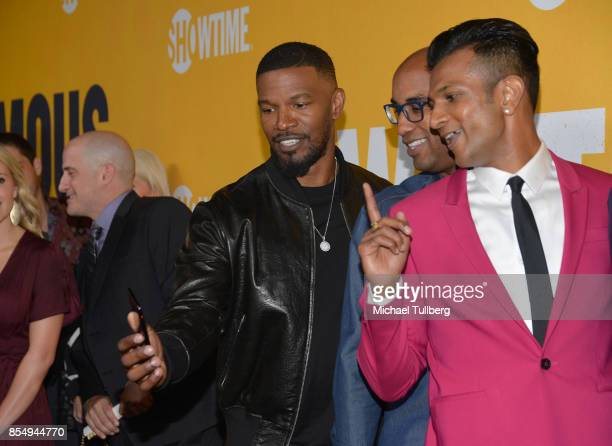 Executive Producers Jamie Foxx and Tim Story and actor Utkarsh Ambudkar take a selfie at the premiere of Showtime's 'White Famous' at The Jeremy...