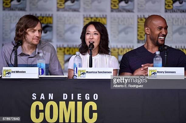 Executive producers Jed Whedon and Maurissa Tancharoen and actor Henry Simmons attend the 'Marvel's Agents of SHIELD' panel during ComicCon...