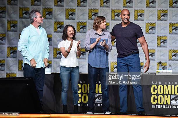 Executive producers Jeffrey Bell Maurissa Tancharoen and Jed Whedon and actor Henry Simmons attend the 'Marvel's Agents of SHIELD' panel during...