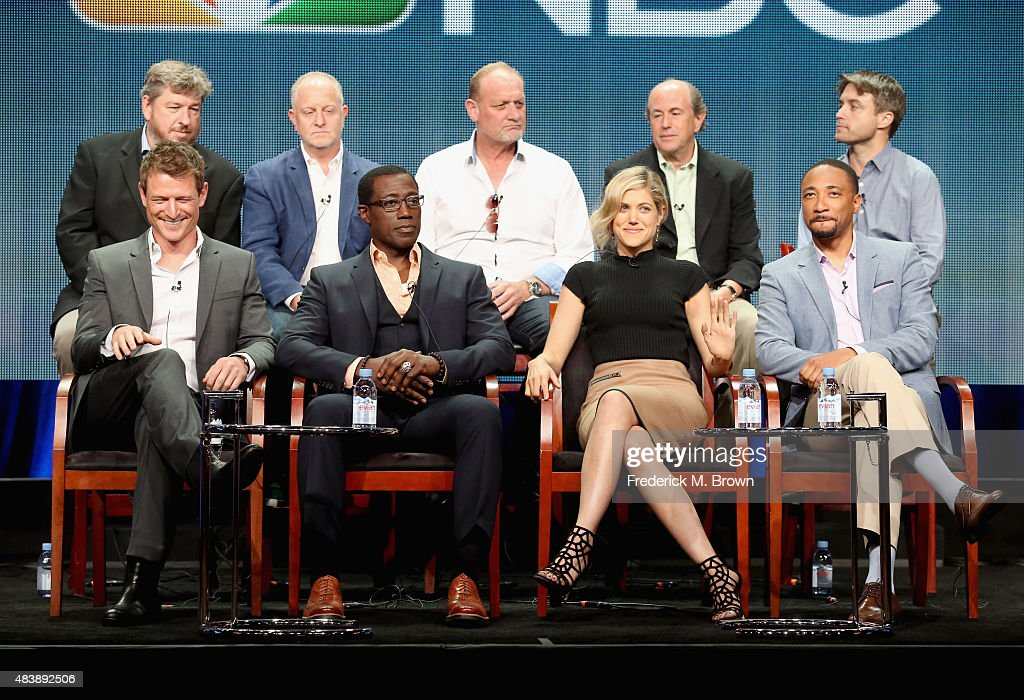 Executive producers John Rogers, John Zinman, Patrick Massett, John Davis, John Fox (Front L-R) actors Philip Winchester, Wesley Snipes, Charity Wakefield and Damon Gupton speak onstage during NBC's 'The Player' panel discussion at the NBCUniversal portion of the 2015 Summer TCA Tour at The Beverly Hilton Hotel on August 13, 2015 in Beverly Hills, California.