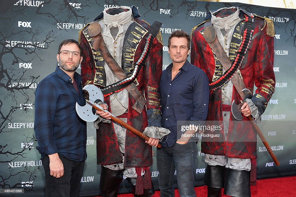 Executive producers Mark Goffman and Len Wiseman pose with headless horsemen at a special screening of Fox's 'Sleepy Hollow' at Hollywood Forever on June 2, 2014 in Hollywood, California.