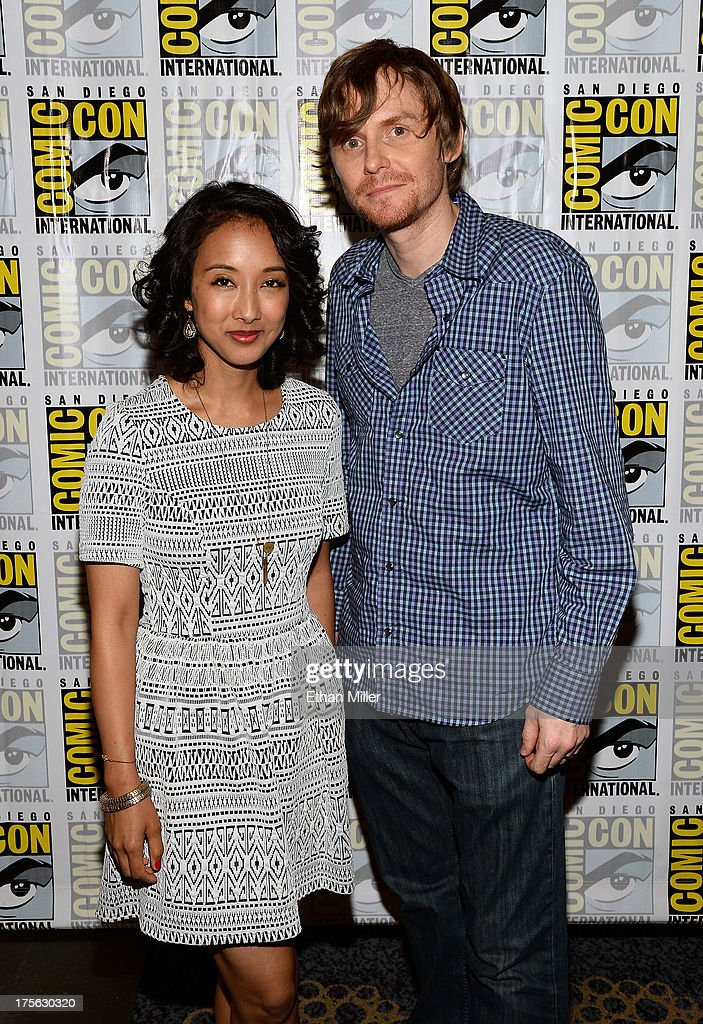 Executive producers Maurissa Tancharoen (L) and Jed Whedon attend Marvel's 'Agents of S.H.I.E.L.D.' press line at the Hilton San Diego Bayfront Hotel on July 19, 2013 in San Diego, California.