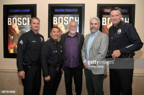 Executive producers Michael Connelly and Henrick Bastin pose with LAPD officers at the Amazon Original Series 'Bosch' special advance screening for...