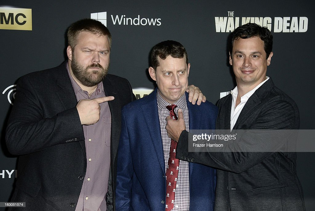 Executive producers <a gi-track='captionPersonalityLinkClicked' href=/galleries/search?phrase=Robert+Kirkman&family=editorial&specificpeople=3951162 ng-click='$event.stopPropagation()'>Robert Kirkman</a>, Scott M. Gimple, and David Alpert arrive at the premiere of AMC's 'The Walking Dead' 4th season at Universal CityWalk on October 3, 2013 in Universal City, California.
