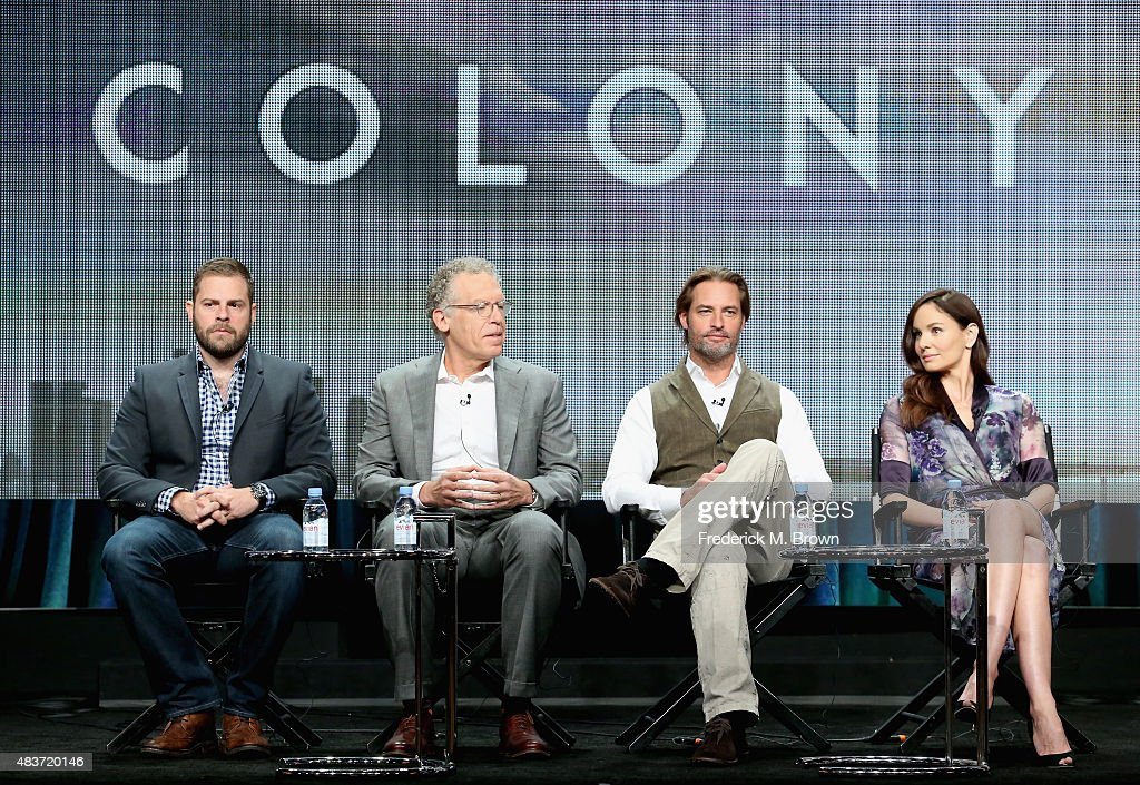 Executive producers Ryan Condal, Carlton Cuse, actors Josh Holloway and Sarah Wayne Callies speak onstage during the USA Networks' 'Colony' panel discussion at the NBCUniversal portion of the 2015 Summer TCA Tour at The Beverly Hilton Hotel on August 12, 2015 in Beverly Hills, California.