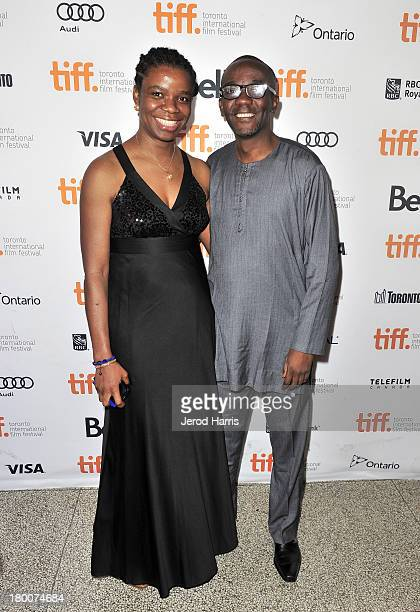 Executive producers Yewande Sadiku and Muhtar Bakare arrive at the 'Half Of A Yellow Sun' Premiere during the 2013 Toronto International Film...