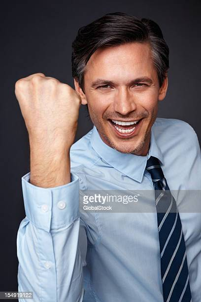 Executive pumping fist with excitement