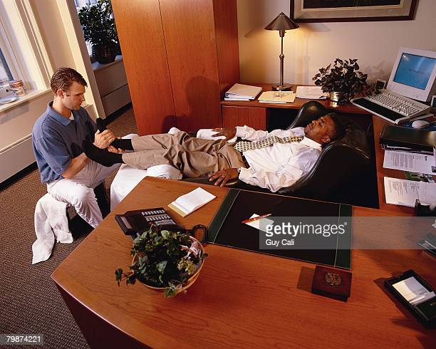 Executive Receiving Foot Massage