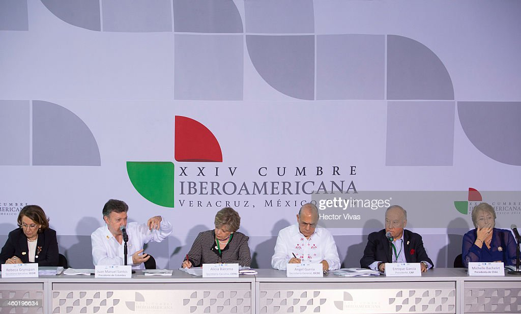Executive Secretary of SEGIB Rebeca Grynspan, President of Colombia <a gi-track='captionPersonalityLinkClicked' href=/galleries/search?phrase=Juan+Manuel+Santos&family=editorial&specificpeople=974752 ng-click='$event.stopPropagation()'>Juan Manuel Santos</a>, General Executive of CEPAL Alicia Barcena, OECD General Secretary Angel Gurria, President of CAF Enrique Garcia and President of Chile <a gi-track='captionPersonalityLinkClicked' href=/galleries/search?phrase=Michelle+Bachelet&family=editorial&specificpeople=547978 ng-click='$event.stopPropagation()'>Michelle Bachelet</a> during the XXIV Ibero-American Summit Veracruz 2014 at World Trade Center on December 09, 2014 in Veracruz, Mexico. The Ibero-American Summit is comprised by the 22 members of the Organization of Ibero-American States, and this year the heads of State and Governments will discuss issues in education, innovation and culture.