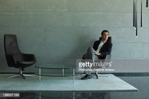 Executive sitting in lobby