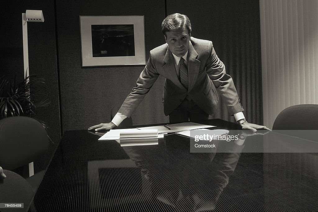 Executive standing in conference room : Stock Photo