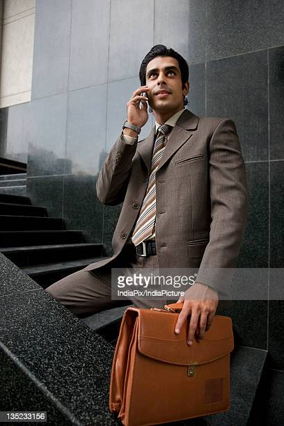 Executive talking on his phone