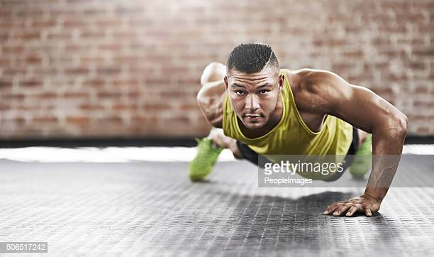 Executive the perfect one-handed pushup
