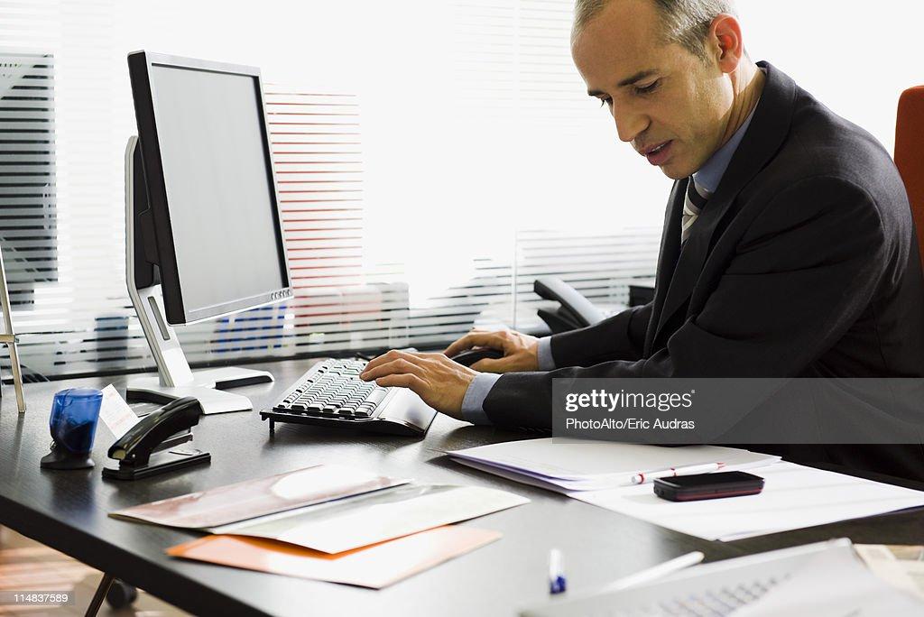 Executive using desktop computer