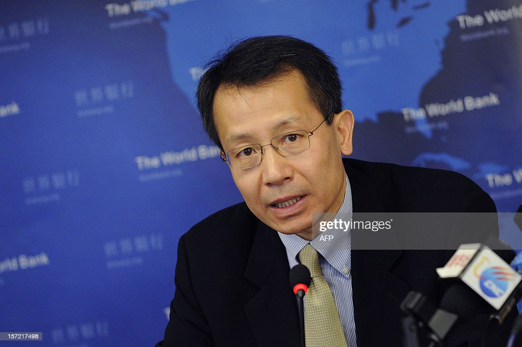 Executive Vice President and CEO of IFC, Jin Yong Cai answers a question during a press conference in Beijing on November 30, 2012. The World Bank is to launch a joint study with Beijing on urbanisation in China, one of the great human migrations of modern times, it said on November 30.