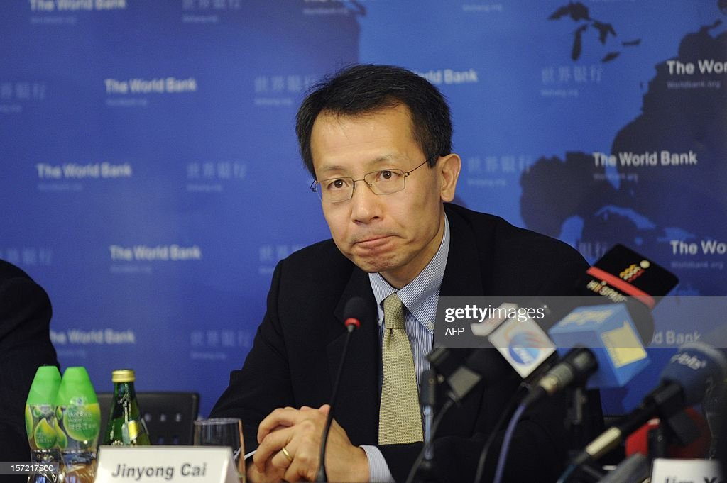 Executive Vice President and CEO of IFC, Jin Yong Cai attends a press conference in Beijing on November 30, 2012. The World Bank is to launch a joint study with Beijing on urbanisation in China, one of the great human migrations of modern times, it said on November 30.