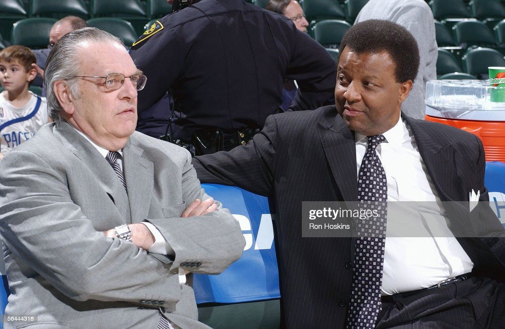 Executive Vice President and General Manager Billy Knight and General Manager Donnie Walsh of the Atlanta Hawks chat in the stands during a game...