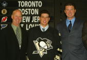 Executive Vice President and General Manager Craig Patrick first overall draft pick Sidney Crosby and Mario Lemieux of the Pittsburgh Penguins pose...