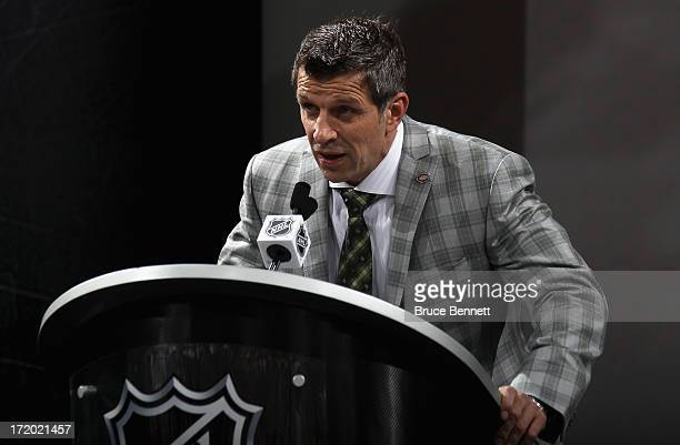 Executive Vice President and General Manager Marc Bergevin of the Montreal Canadiens speaks at the podium during the 2013 NHL Draft at the Prudential...
