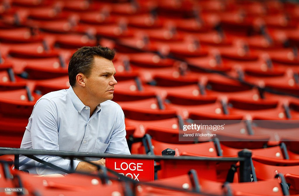 Executive Vice President and General Manager of the Boston Red Sox, Ben Cherington, watches batting practice prior to the game between the Boston Red Sox and the New York Yankees on August 18, 2013 at Fenway Park in Boston, Massachusetts.