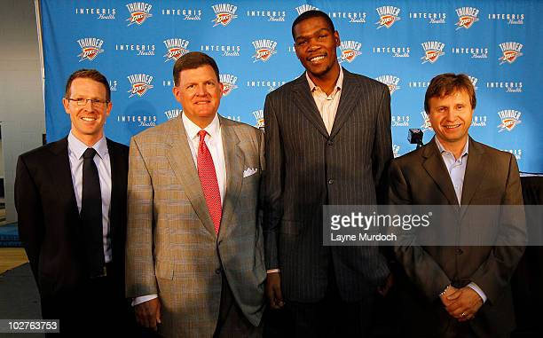 Executive Vice President and General Manager Sam Presti Chairman Clay Bennett Kevin Durant and Head Coach Scott Brooks of the Oklahoma City Thunder...