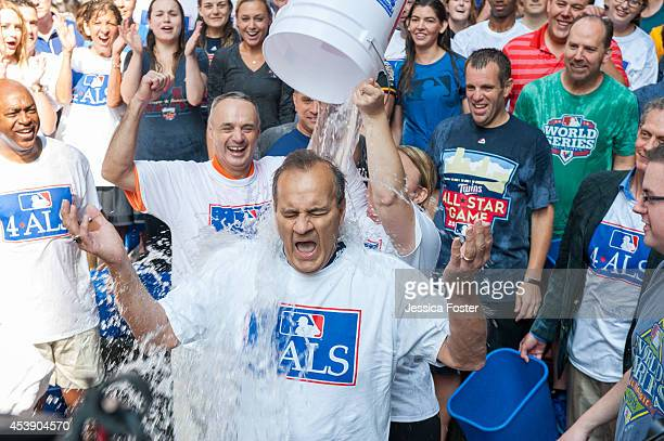 Executive Vice President Baseball Operations Joe Torre participates in the ice bucket challenge along with MLB employees at the MLB Headquarters on...
