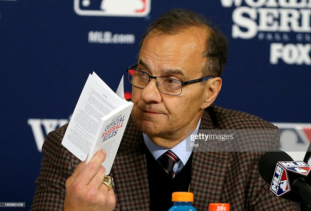 MLB executive vice president for baseball operations <a gi-track='captionPersonalityLinkClicked' href=/galleries/search?phrase=Joe+Torre&family=editorial&specificpeople=204583 ng-click='$event.stopPropagation()'>Joe Torre</a> participates in a news conference regarding the obstruction call against Will Middlebrooks #16 of the Boston Red Sox leading to the winning run in the ninth inning of Game Three of the 2013 World Series against the St. Louis Cardinals at Busch Stadium on October 26, 2013 in St Louis, Missouri.