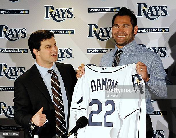 Executive Vice President of Baseball Operations Andrew Friedma poses with Johnny Damon of the Tampa bay Rays during a press conference at Tropicana...