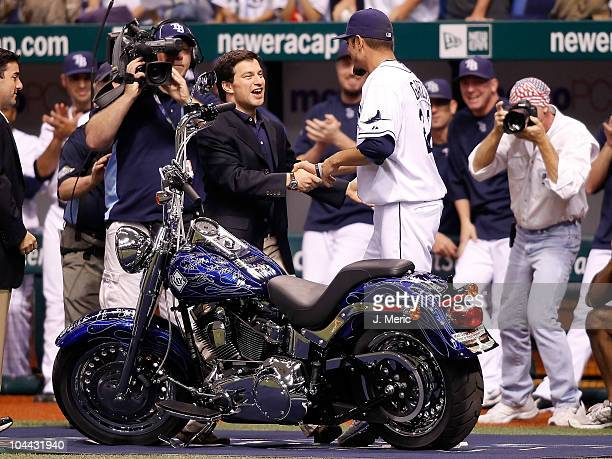 Executive Vice President of Baseball Operations Andrew Friedman of the Tampa Bay Rays presents pitcher Matt Garza with a Harley Davidson motorcycle...
