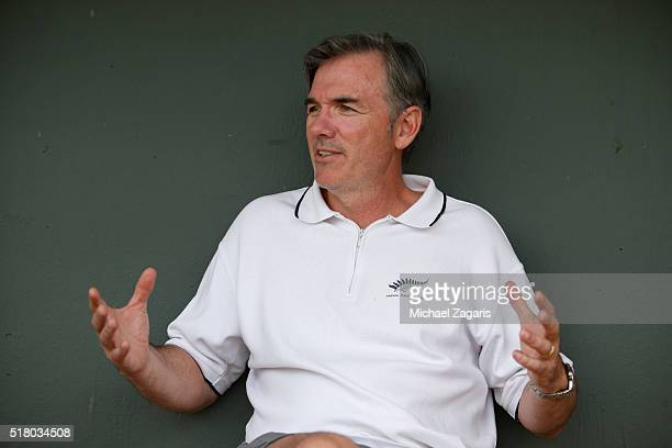 Executive Vice President of Baseball Operations Billy Beane of the Oakland Athletics relaxes in the dugout prior to a spring training game against...