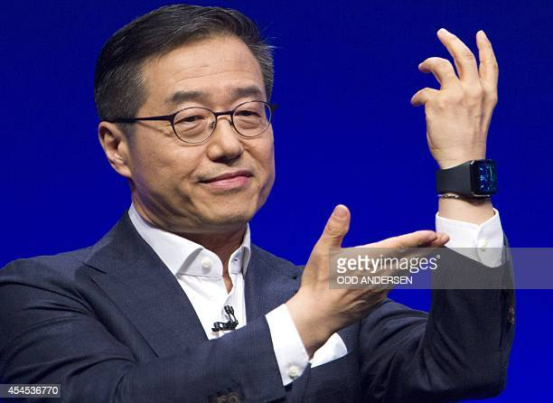 Executive Vice President of electronics giant Samsung D J Lee presents the Samsung Gear S a new mobile watch on the eve of the opening of the...